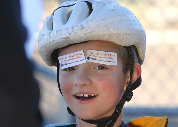 Maxim Tuell, 7, put stickers for Walk or Bike to School Day on his eyebrows after walking to Kohl Elementary School on Wednesday. <br /> <br /> October 7, 2009<br /> Staff photo/David R. Jennings