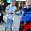 Andy McMahaon, 6, left, with his brother Kevin, 6, and Hall Edmonds, 6, rode scooters to school on Wednesday during Walk or Bike to School Day at Kohl Elementary School.<br /> <br /> October 7, 2009<br /> Staff photo/David R. Jennings