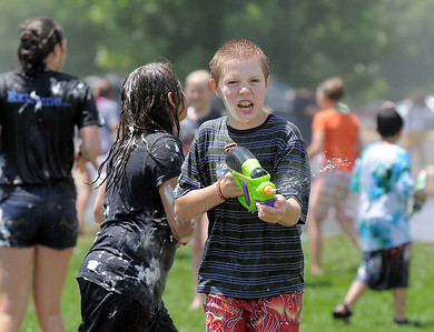 Anthony Bridges, 11, hunts for people to squirt with a water gun during the water fight marking the last day of the Totus Tuus program at Nativity of Our Lord Church and School on Friday. June 17, 2011 staff photo/David R. Jennings