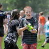 Anthony Bridges, 11, hunts for people to squirt with a water gun during the water fight marking the last day of the Totus Tuus program at Nativity of Our Lord Church and School on Friday.<br /> June 17, 2011<br /> staff photo/David R. Jennings
