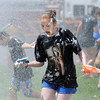 Emma Shileny, 11, reacts while beign hit with water sprayed on the students by North Metro Fire Rescue firefighters during the water fight marking the last day of the Totus Tuus program at Nativity of Our Lord Church and School on Friday.<br /> June 17, 2011<br /> staff photo/David R. Jennings
