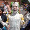 Connor Gray, 11, waits to be rinsed off after the water fight marking the last day of the Totus Tuus program at Nativity of Our Lord Church and School on Friday.<br /> June 17, 2011<br /> staff photo/David R. Jennings