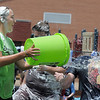 Brenna Fankell, 13, throws a bucket of water on Steven DiMassimo during the water fight marking the last day of the Totus Tuus program at Nativity of Our Lord Church and School on Friday.<br /> June 17, 2011<br /> staff photo/David R. Jennings