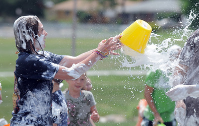 Alexa Biggerstaff, 16, throws water on children during the water fight marking the last day of the Totus Tuus program at Nativity of Our Lord Church and School on Friday. June 17, 2011 staff photo/David R. Jennings