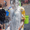 Connor Gray, 11, has shaving cream cleaned off with water after the water fight marking the last day of the Totus Tuus program at Nativity of Our Lord Church and School on Friday.<br /> June 17, 2011<br /> staff photo/David R. Jennings