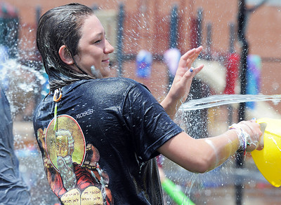 Alexa Biggerstaff, 16, is is drenched in water during the water fight marking the last day of the Totus Tuus program at Nativity of Our Lord Church and School on Friday. June 17, 2011 staff photo/David R. Jennings
