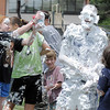 Emma Shilney, 11, adds more shaving cream to Steven DiMassimo, right, one of the head counselors, during the water fight marking the last day of the Totus Tuus program at Nativity of Our Lord Church and School on Friday.<br /> June 17, 2011<br /> staff photo/David R. Jennings