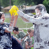 Alexa Biggerstaff, 16, left, tries to get water on Mark Thomason, director of the program, covered in shaving cream,  during the water fight marking the last day of the Totus Tuus program at Nativity of Our Lord Church and School with water from the air supplied by North Metro Fire Rescue on Friday.<br /> June 17, 2011<br /> staff photo/David R. Jennings