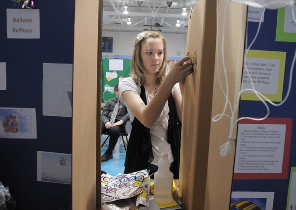 Westlake Middle School 8th grader Casey Harmon puts some final touches to her exhibit for the science fair show at the school on Thursday.<br /> April 7, 2011<br /> staff photo/David R. Jennings