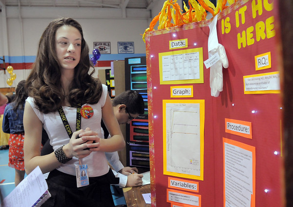 Carlie Preskitt, an 8th grader at Westlake Middle School, explains her chemistry experiment  to determine enthalpy of thermodynamic reactions during the science fair show at the school on Thursday.<br /> April 7, 2011<br /> staff photo/David R. Jennings