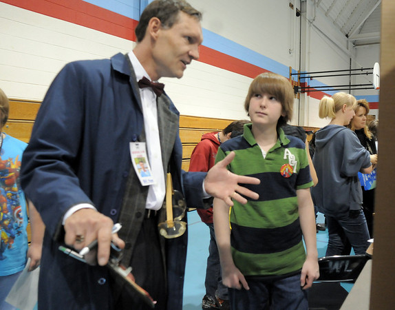 "Westlake Middle School counselor Danny Austin dressed as ""Bill Nye the Science Guy"" questions 7th grader Logan Schwanz about his project titled ""Texting While Driving"" during the science fair show at the school on Thursday.<br /> April 7, 2011<br /> staff photo/David R. Jennings"