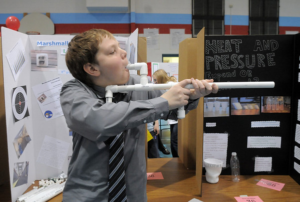 Westlake Middle School 8th grader Nick VanArsdale demonstrates his marshmallow launcher during the science fair show at the school on Thursday.<br /> April 6, 2011<br /> staff photo/David R. Jennings