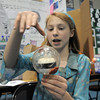 Layla Clark, a 7th grader at Westlake Middle School, shows how she tried to simulate cyclone or hurricane behavior in a clear ball and how temperature affects the formation during the science fair show at the school on Thursday.<br /> April 7, 2011<br /> staff photo/David R. Jennings