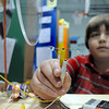 Westlake Middle School 8th grader Andrew Schmitt holds a pair of LED lights while  demonstrating his magnetic generator during the science fair show at the school on Thursday.<br /> April 7, 2011<br /> staff photo/David R. Jennings