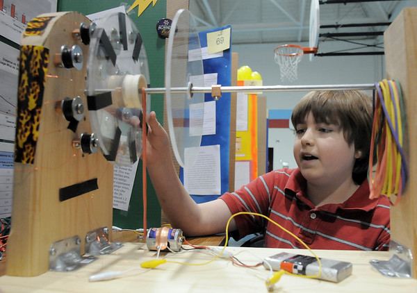 Andrew Schmitt,  an 8th grader at Westlake Middle School, demonstrates his magnetic generator during the science fair show at the school on Thursday.<br /> April 7, 2011<br /> staff photo/David R. Jennings