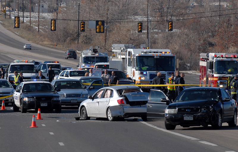 The scene of a Westminster Police shoot out at eastbound 120th Ave. and Federal Blvd. on Thursday. the silver vehicle is the suspects.<br /> Two Westminster officers were shot in the gun battle. Federal is closed both directions from Federal Blvd. to Pecos St.<br /> November 19, 2009<br /> Staff photo/David R. Jennings