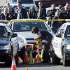 Criminalists from Wesminster and Broomfield begin marking rounds at the scene of a shoot out with Westminster Police at eastbound 120th Ave. and Federal Blvd. on Thursday.<br /> Two Westminster officers were shot in the gun battle. Federal is closed both directions from Federal Blvd. to Pecos St.<br /> November 19, 2009<br /> Staff photo/David R. Jennings