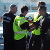 A Federal Heights paramedic examines a Westminster officer at the scene of a Westminster Police shoot out at eastbound 120th Ave. and Federal Blvd. on Thursday.<br /> Two Westminster officers were shot in the gun battle. Federal is closed both directions from Federal Blvd. to Pecos St.<br /> November 19, 2009<br /> Staff photo/David R. Jennings