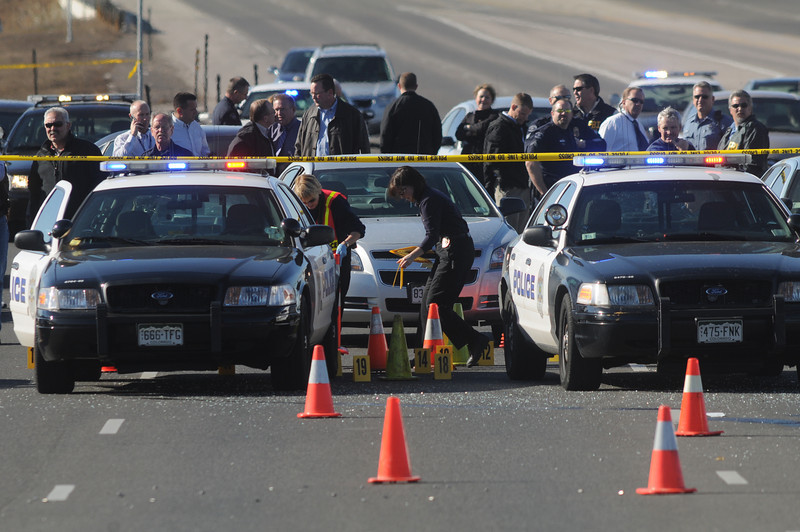 Broomfield and Westminster Police criminalists begin marking rounds at the scene of a Westminster Police shoot out at eastbound 120th Ave. and Federal Blvd. on Thursday.<br /> Two Westminster officers were shot in the gun battle. Federal is closed both directions from Federal Blvd. to Pecos St.<br /> November 19, 2009<br /> Staff photo/David R. Jennings