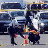 Broomfield Police criminalist Brenda Harris, left, and a Westminster criminalist marks rounds at the scene of a shoot out with Westminster Police at eastbound 120th Ave. and Federal Blvd. on Thursday.<br /> Two Westminster officers were shot in the gun battle. Federal is closed both directions from Federal Blvd. to Pecos St.<br /> November 19, 2009<br /> Staff photo/David R. Jennings