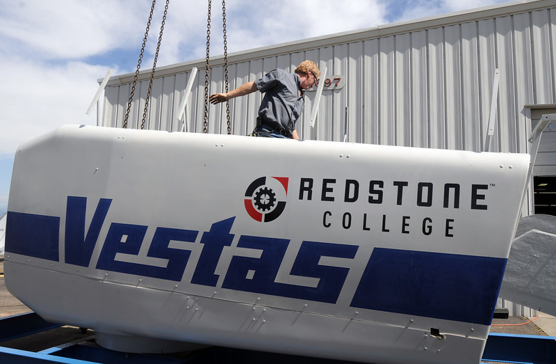 BE0617TURBINE06<br /> Rick Leeds, Redstone College, stands in the Vestas V27 wind turbine head delivered to  the school on Thursday.  The college is planning on launching a new Wind Energy Technology Program later this summer. The wind turbine will be used for hands-on training.<br /> <br /> June 10, 2010<br /> Staff photo/ David R. Jennings