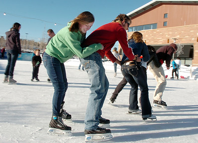 Annie Hodgson, 15, left, hangs on to her brother Daniel Hodgson as they go around the ice rink in a line with Tayor Balthazor, Anisha Mathi and Johnny Hodgson at the Winter Skate ice rink  at the FlatIron Crossing mall on Friday.  December 23, 2011 staff photo/ David R. Jennings