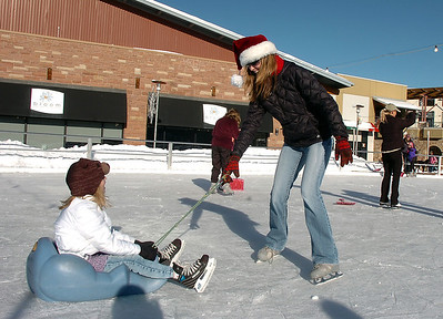 Shelley Paterson, right, pulls her daughter Brynne, 6, at the  Winter Skate ice rink  at the FlatIron Crossing mall on Friday. The Paterson family came from Windsor to skate at the rink.  December 23, 2011 staff photo/ David R. Jennings