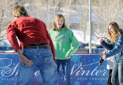 Annie Hodgson, 15, center, laughs while skating with her brother Daniel, left, and Taylor Balthazor while ice skating at the Winter Skate ice rink at the FlatIron Crossing mall on Friday.  December 23, 2011 staff photo/ David R. Jennings