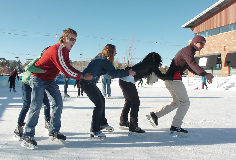 Johnny Hodgson, right, leads the line of Anisha Mathi, Taylor Balthazor Daniel Hodgson and Annie Hodgson, 15, while skating at the  Winter Skate ice rink  at the FlatIron Crossing mall on Friday.<br /> <br /> December 23, 2011<br /> staff photo/ David R. Jennings