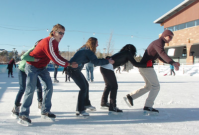 Johnny Hodgson, right, leads the line of Anisha Mathi, Taylor Balthazor Daniel Hodgson and Annie Hodgson, 15, while skating at the  Winter Skate ice rink  at the FlatIron Crossing mall on Friday.  December 23, 2011 staff photo/ David R. Jennings