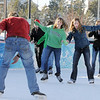 Annie Hodgson, 15, center, and Taylor Balthazor skate towards Daniel Hodgson at the Winter Skate ice rink  at the FlatIron Crossing mall on Friday.<br /> <br /> December 23, 2011<br /> staff photo/ David R. Jennings