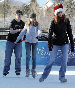 Kyler Paterson, 14, left, skates with his sister Kailey, 12, and mother Shelley at the Winter Skate ice rink  at the FlatIron Crossing mall on Friday.  December 23, 2011 staff photo/ David R. Jennings