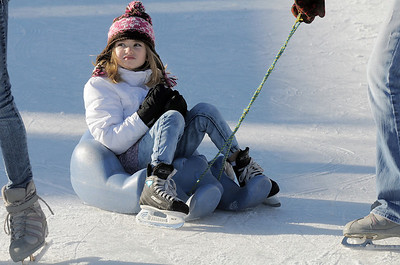 Brynne Paterson, 6, from Windsor, is pulled around the rink by family members at the Winter Skate ice rink  at the FlatIron Crossing mall on Friday.  December 23, 2011 staff photo/ David R. Jennings