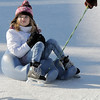 Brynne Paterson, 6, from Windsor, is pulled around the rink by family members at the Winter Skate ice rink  at the FlatIron Crossing mall on Friday.<br /> <br /> December 23, 2011<br /> staff photo/ David R. Jennings