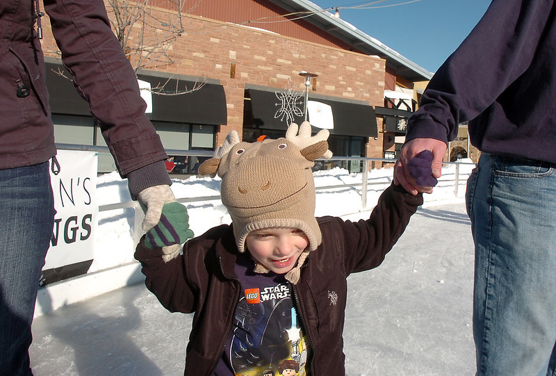 Jack Cooney, 4, skates with his parents Jenn and Sean, from Thornton, at the Winter Skate ice rink  at the FlatIron Crossing mall on Friday.<br /> <br /> December 23, 2011<br /> staff photo/ David R. Jennings
