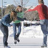 Taylor Balthazor, left, and Annie Hodgson, 15, ice skate with Daniel Hodgson at the Winter Skate ice rink  at the FlatIron Crossing mall on Friday.<br /> <br /> December 23, 2011<br /> staff photo/ David R. Jennings