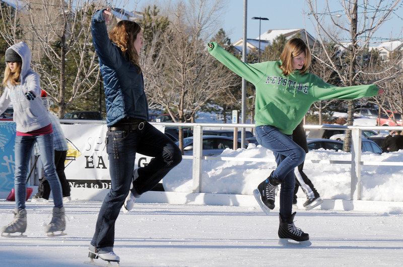 Taylor Balthazor, left, ice skates with Annie Hodgson, 15, both from Boulder, at the Winter Skate ice rink  at the FlatIron Crossing mall on Friday.<br /> <br /> December 23, 2011<br /> staff photo/ David R. Jennings
