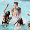 be0616swimlesson05<br /> Life guard instructor Eli Davis is splashed by participants after the World's Largest Swimming Lesson sponsored by the Kiwanis at the Bay Aquatic Center on Tuesday.<br /> June 14, 2011<br /> staff photo/David R. Jennings