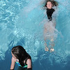 Anna Barjenbruch, 11, right, pushes off the edge of the pool while Marlow Anderson, 8, waits her turn during the World's Largest Swimming Lesson sponsored by the Kiwanis at the Bay Aquatic Center on Tuesday.<br /> June 14, 2011<br /> staff photo/David R. Jennings