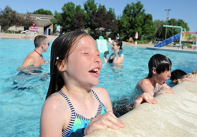 Marlow Anderson, 8, bobs up and down in the water during the World's Largest Swimming Lesson sponsored by the Kiwanis at the Bay Aquatic Center on Tuesday. June 14, 2011 staff photo/David R. Jennings