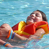 Victoria Ruelas, 10, floats with a life jacket during the World's Largest Swimming Lesson sponsored by the Kiwanis at the Bay Aquatic Center on Tuesday.<br /> June 14, 2011<br /> staff photo/David R. Jennings