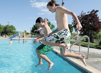 Forest Garrigan, 13, and Brock Abeyta, 13,  learn to do a safe jump off of the pool during the World's Largest Swimming Lesson sponsored by the Kiwanis at the Bay Aquatic Center on Tuesday. June 14, 2011 staff photo/David R. Jennings
