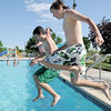 Forest Garrigan, 13, and Brock Abeyta, 13,  learn to do a safe jump off of the pool during the World's Largest Swimming Lesson sponsored by the Kiwanis at the Bay Aquatic Center on Tuesday.<br /> June 14, 2011<br /> staff photo/David R. Jennings