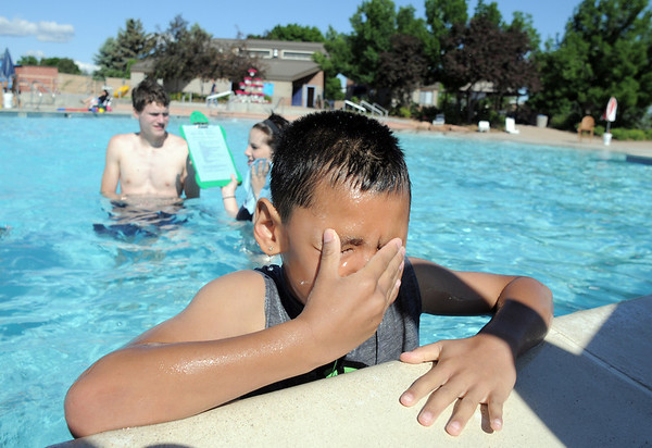 Beginning swimmer Alex Rodriguez, 8, wipes his eyes after going under the water during the World's Largest Swimming Lesson sponsored by the Kiwanis at the Bay Aquatic Center on Tuesday.<br /> June 14, 2011<br /> staff photo/David R. Jennings
