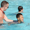 Instructor and life guard Eli Davis helps beginning swimmer Alex Rodriguez, 8, to swim during the World's Largest Swimming Lesson sponsored by the Kiwanis at the Bay Aquatic Center on Tuesday.<br /> June 14, 2011<br /> staff photo/David R. Jennings