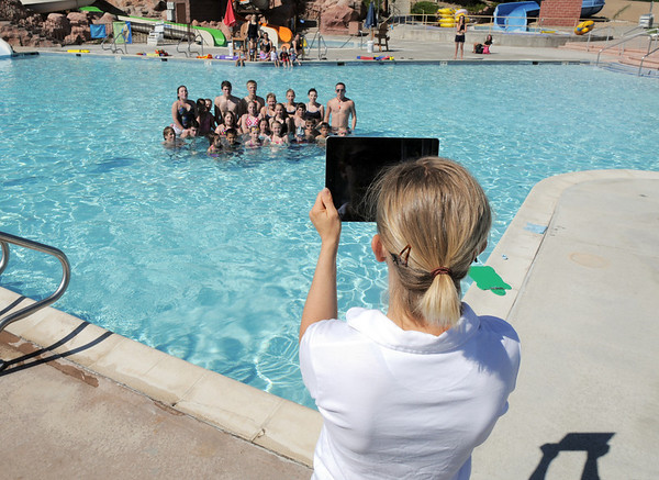 Dawn Rachjaibun, aquatics manager for Broomfield, takes a picture of participants in the World's Largest Swimming Lesson sponsored by the Kiwanis at the Bay Aquatic Center on Tuesday.<br /> June 14, 2011<br /> staff photo/David R. Jennings