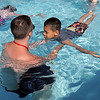 Life guard instructor Eli Davis helps beginning swimmer Alex Rodriguez, 8, float during the World's Largest Swimming Lesson sponsored by the Kiwanis at the Bay Aquatic Center on Tuesday.<br /> June 14, 2011<br /> staff photo/David R. Jennings
