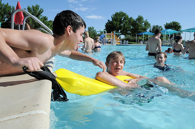 Brock Abeyta, 13, left, practices a rescue with Forest Garrigan, 13,  during the World's Largest Swimming Lesson sponsored by the Kiwanis at the Bay Aquatic Center on Tuesday. June 14, 2011 staff photo/David R. Jennings