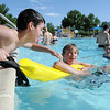 Brock Abeyta, 13, left, practices a rescue with Forest Garrigan, 13,  during the World's Largest Swimming Lesson sponsored by the Kiwanis at the Bay Aquatic Center on Tuesday.<br /> June 14, 2011<br /> staff photo/David R. Jennings