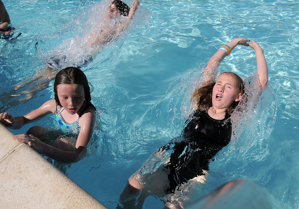 Marlow Anderson, 8, left, and Anna Barjenbruch, 11, push off the edge of the pool during the World's Largest Swimming Lesson sponsored by the Kiwanis at the Bay Aquatic Center on Tuesday.<br /> June 14, 2011<br /> staff photo/David R. Jennings